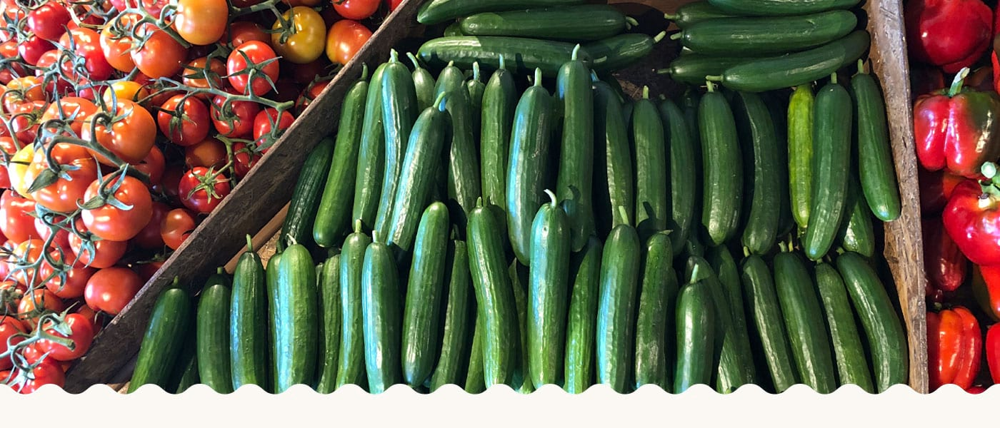 Cucumbers, tomatoes and capsicums on display