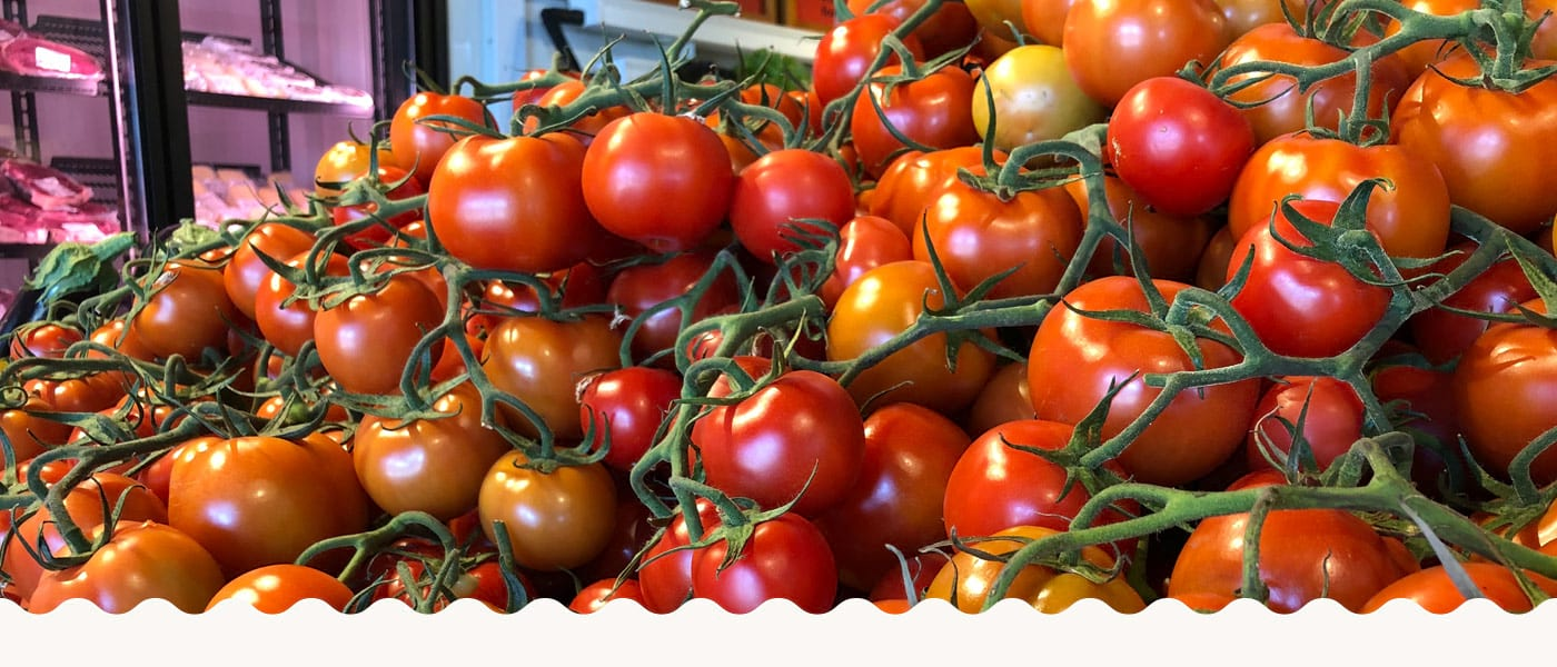 Tomatoes on Display in Produce Store
